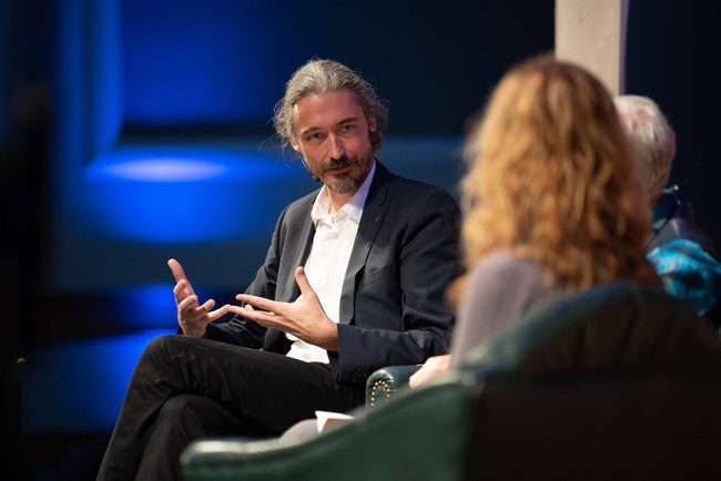 Thomas Hübl discussing collective trauma at the Science and Non-Duality Conference in 2018 (PRNewsfoto/Inner Science LLC)
