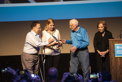 Former President Jimmy Carter and former First Lady Rosalynn Carter mark the announcement of the 2020 Carter Work Project by passing a ceremonial trowel to Cesarina Fabián and Celso Marranzini representing Habitat for Humanity Dominican Republic.