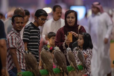 Visitors attending the 2nd Saudi Falcons and Hunting Exhibition - Riyadh, Saudi Arabia