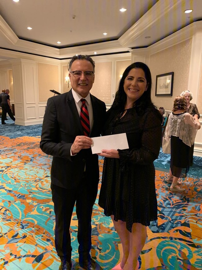 Dr. Farshchian donating to the charity event