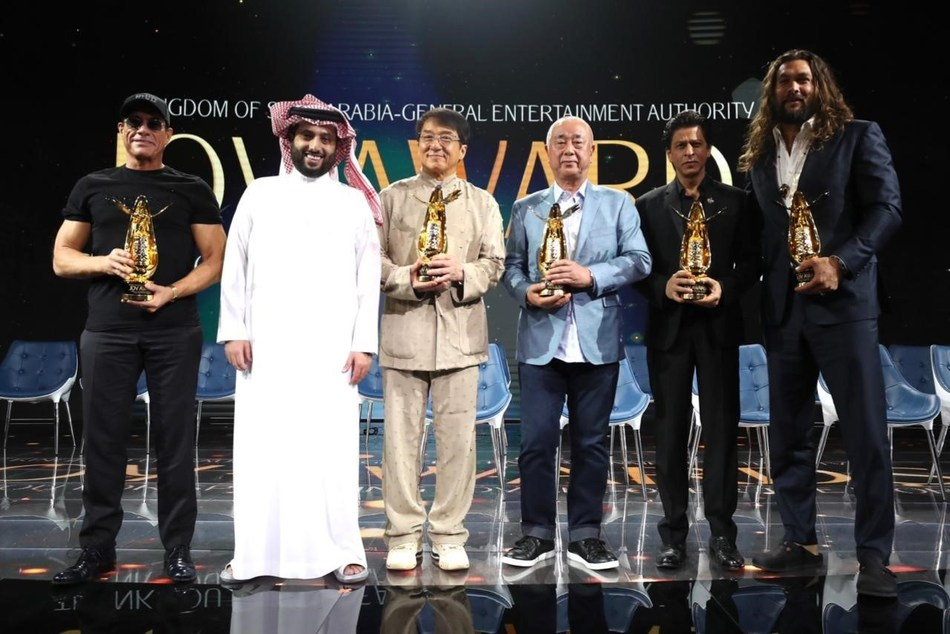 "Pictured from left to right: Jean-Claude Van Damme, GEA Chairman Turki al Sheikh, Jackie Chan, Shah Rukh Khan, Nobuyuki ""Nobu"" Matsuhisa and Jason Momoa."