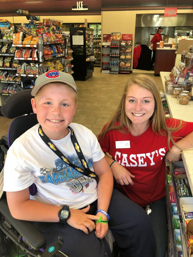 MDA Ambassador visits with Casey's store associate to say thank you for supporting MDA.