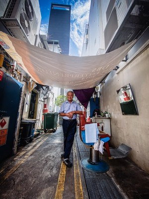 Streetside Barber at Telok Ayer Against The Clan Hotel Singapore by Aik Beng Chia