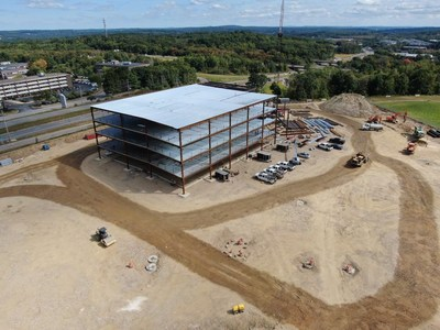 """A """"Topping Off"""" celebration at the Olympus Westborough site was held to celebrate the coming opening in 2021."""