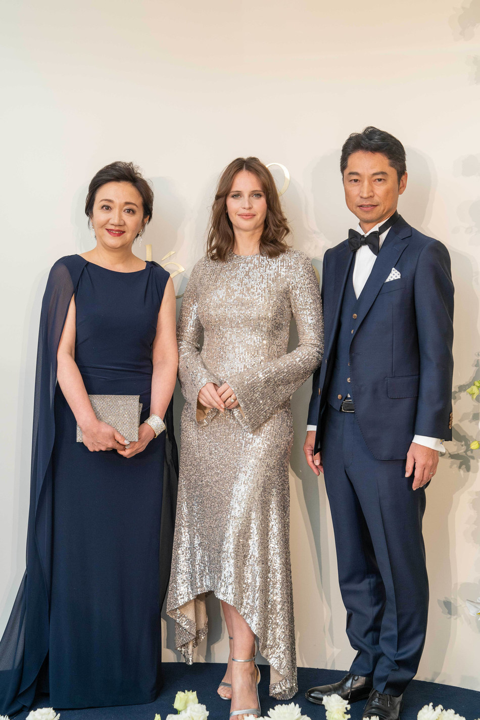 Ms Yukari Suzuki, Clé de Peau Beauté Chief Brand Officer, Ms Felicity Jones, Clé de Peau Beauté Global Brand Ambassador and Mr Katsunori Yoshida, Clé de Peau Beauté Lab Chief Technology Officer celebrate the launch of the new La Crème at a private gala dinner hosted at Corinthia Hotel London