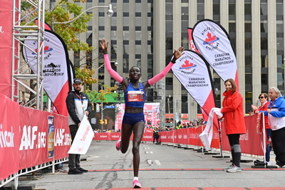 Magdalyne Masai from Kenya wins the Scotiabank Toronto Waterfront Marathon, with a time of 2:22:16. (Todd Fraser, Canada Running Series) (CNW Group/Scotiabank)
