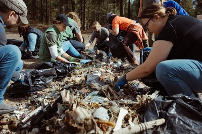 REI employees participate in trail clean up in Bend, Oregon. Courtesy of REI.