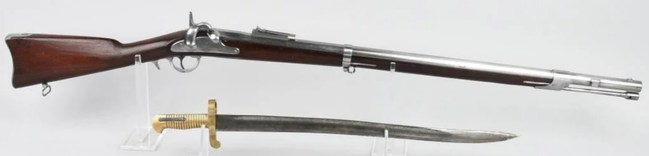 Near-mint unissued Whitney Model 1861 US Navy rifle, barrel dated 1863, .69 caliber, large eagle-and-flag motif on lock. Bayonet made by Collins & Co. (Hartford, Conn.). Estimate: $6,000-$8,000