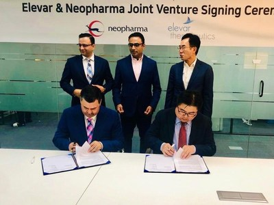 Standing L to R - Sumit Bhanot - CMO, Neopharma; Vamsi Maddipatla - CEO, Therapiva; Yang-Gon Jin - Charmain, Hlb Inc. Signing L to R - Suresh Nandiraju - Dy CEO, Neopharma; Sung-Woo Kim – CFO, Hlb Inc.