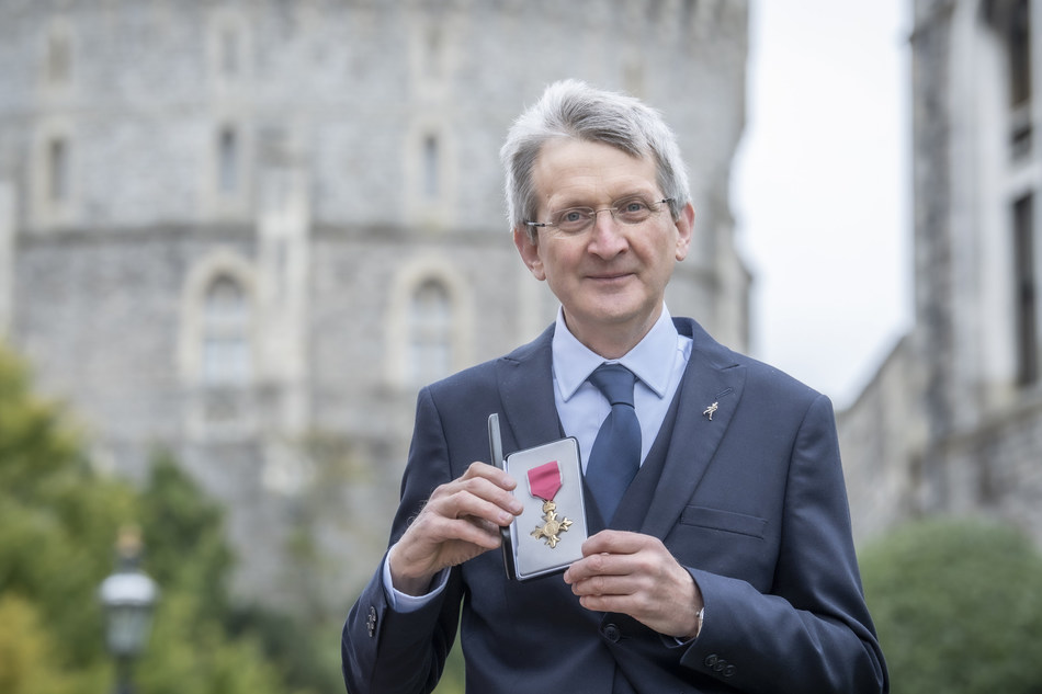 Dr. Jim Beveridge is awarded an OBE by Her Majesty the Queen at Windsor Castle.