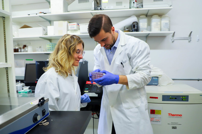 Because Animals CEO, Dr. Shannon Falconer, examines animal cells with tissue scientist, Taylor Brooks, in the startup's lab.