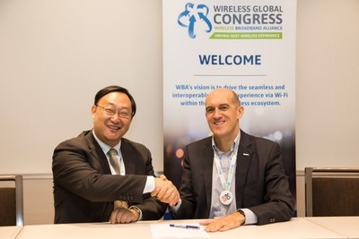 Tiago Rodrigues (right), WBA CEO and Li Xing (left), Vice President of Huawei's Campus Network Domain, sign at Wireless Global Congress