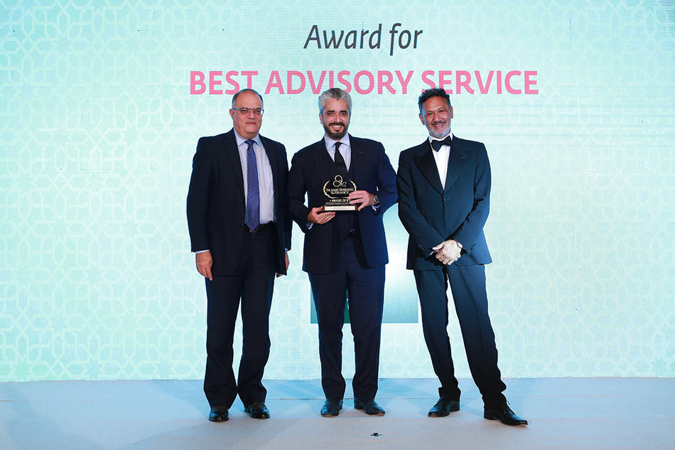 """Mr. Omar Al-Gharabally (center), President and Partner of Greenstone Equity Partners, accepting the """"Best Advisory Service"""" award from executives of CPI Financial."""