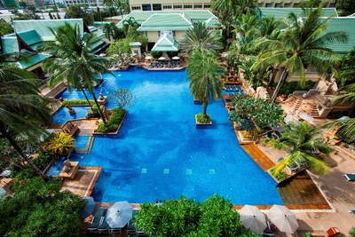 The Main Pool at the newly renovated Busakorn Wing of the Holiday Inn, Phuket where tropical sophistication meets traditional Thai luxury.