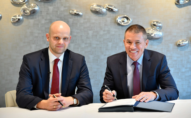 Norwegian Cruise Line takes delivery of Norwegian Encore from Meyer Werft. (Tim Meyer, managing director of Meyer Werft and Andy Stuart, president and CEO of Norwegian Cruise Line.)