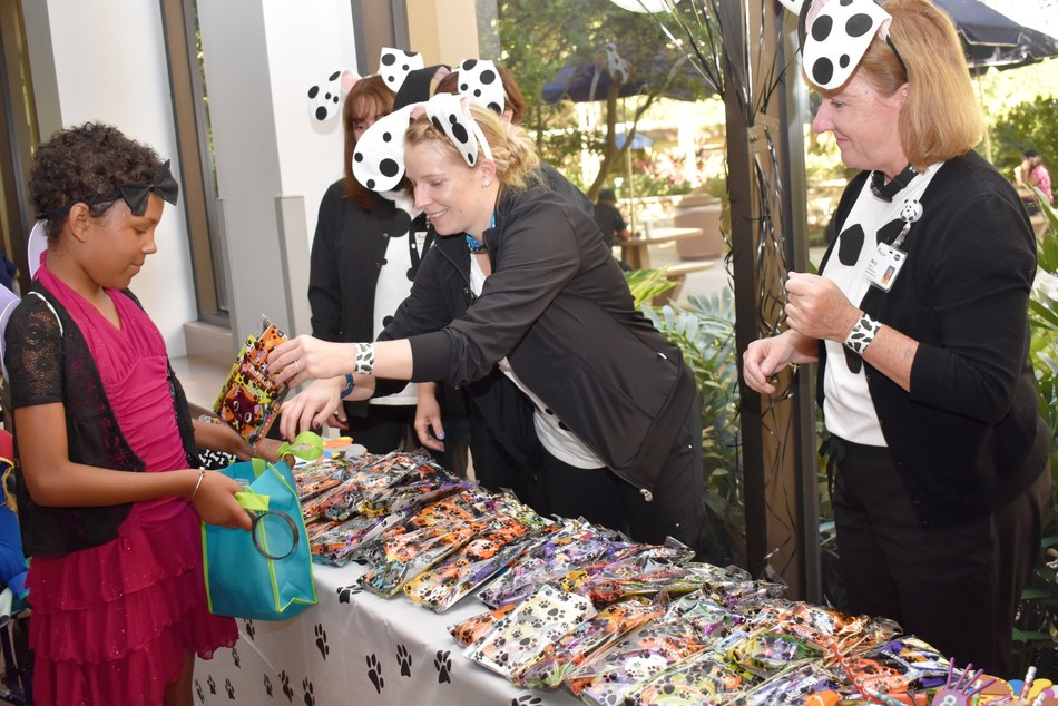St. Joseph's Children's Hospital patient Shanella Fisher, age 9, loaded up on treats and fun during a special Halloween parade held at the Tampa hospital on Thursday, Oct. 31, 2019.