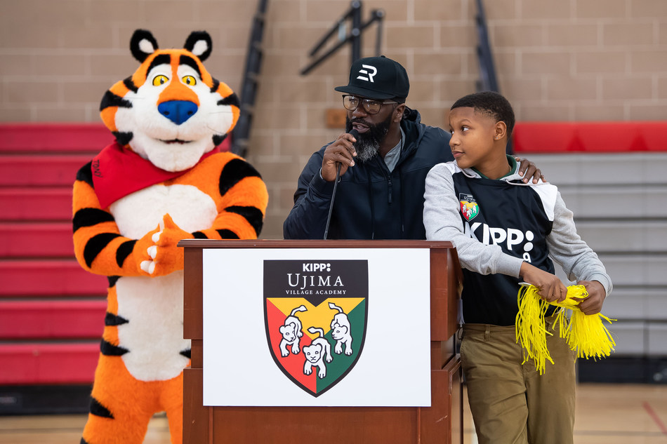 Ed Reed, Pro Football Hall of Famer and former Baltimore Raven, and Tony the Tiger celebrate Mission Tiger – Kellogg's Frosted Flakes' new initiative to save middle school sports. Ed Reed and Tony the Tiger surprised 7th and 8th graders with a Mission Tiger donation for a new baseball field, sports equipment, gym renovations, uniforms, and more at the school on Friday, Nov.1, in Baltimore. (Joy Asico/AP Images for Kellogg's Frosted Flakes)