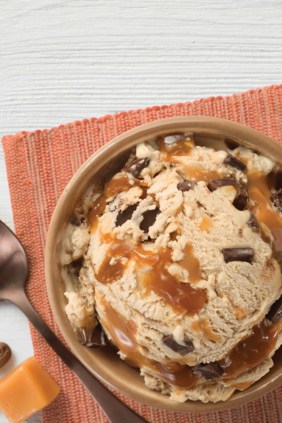 Baskin-Robbins' November Flavor of the Month, Non-Dairy and Vegan Coffee Caramel Chunk, is a plant-based, espresso-flavored ice cream full of chocolate chunks and covered with a caramel ribbon. For more information, visit www.baskinrobbins.com.