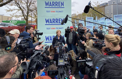 Elizabeth Warren with reporters outside the Liberty and Justice Celebration in Des Moines on Friday