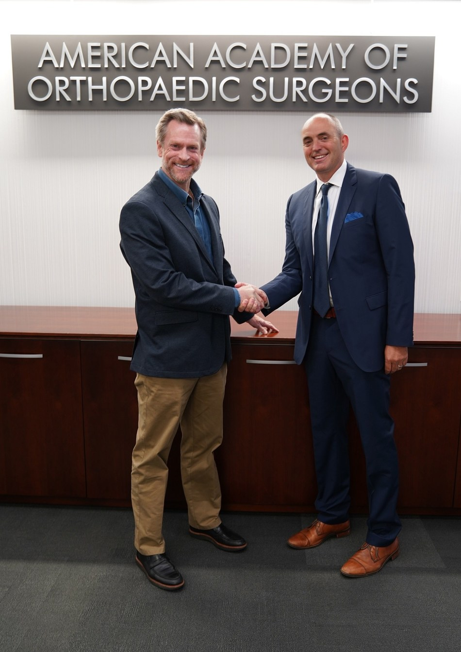 Pictured here: Tom Arend (AAOS) and Gregory Pierce (CareCredit)