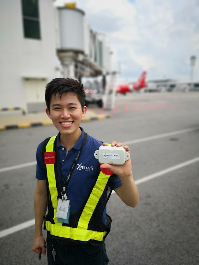 Xperanti Engineer holding a Digital Matter Oyster Sigfox Battery Powered Tracking Device