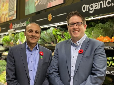 Ken Keelor (l) CEO Calgary Co-op and Adam Martin (r), General Manager Community Natural Foods at Community Natural Foods Chinook Market Location on November 4, 2019. The sale of Community Natural Foods to Calgary Co-op is part of the succession plan for Community Natural Foods' owner and represents a coming together of two long-time community-focused Calgary retailers. (CNW Group/Calgary Co-Operative Association Limited (Calgary Co-op))