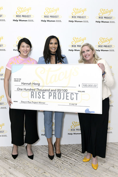 """NEW YORK, NEW YORK - NOVEMBER 04: Ahead of Womens Entrepreneurship Day, entrepreneur Padma Lakshmi (C) and Jessica Spaulding (R) of Stacy's Pita Chips announce entrepreneur Hannah Hong, founder of Hakuna Brands, as the $100,000 grand prize winner of the inaugural """"Stacy's Rise Project"""" at a female empowerment luncheon on November 04, 2019, in New York City. (Photo by Eugene Gologursky/Getty Images for Stacy's Pita Chips)"""