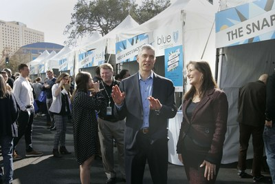 Blue Shield of California CEO Paul Markovich (center) speaks with Oakland Mayor Libby Schaaf (right) during a ribbon-cutting celebration for the nonprofit health plan's new Oakland headquarters on Monday