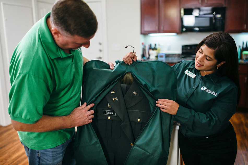 Celebrity Fitness: Navy veteran and Valet Giving Hero recipient, Andrew Durbin, receives his laundry delivery from Valet Living Associate Valerie Hernandez.