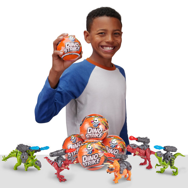 5 Surprise Dino Strike, the new series in ZURU's sought-after 5 Surprise product line, features the fun excitement of unwrapping, peeling and revealing mystery capsules.  The best-selling 5 Surprise brand has shipped over 17 million capsules around the globe since its debut last year.