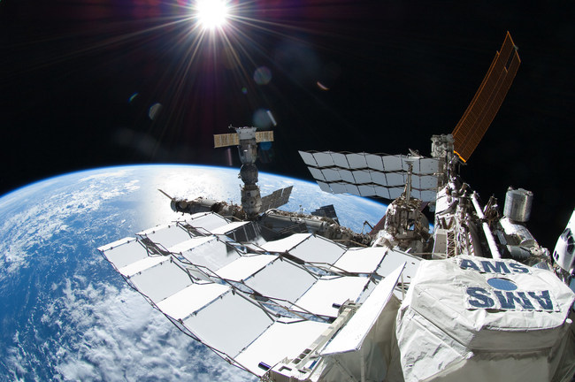 This picture, taken July 12, 2011, shows the Alpha Magnetic Spectrometer (AMS) experiment on the International Space Station. AMS is a state-of-the-art particle physics detector designed to search for antimatter and dark matter. Credit: NASA/Ron Garan