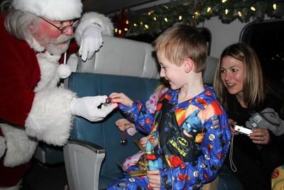 Santa greets each boy and girl on board.