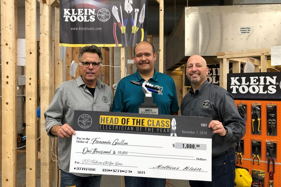 2019 Electrician of the Year winner Fernando Guillen (center) receives award from members of the Klein Tools team, Barnaby, host (left), and Greg Palese, vice president of marketing (right).
