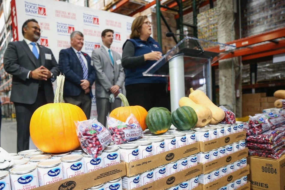 Ocean Spray CEO and President Bobby Chacko, The Greater Boston Food Bank President and CEO Catherine D'Amato, and government officials at The Greater Boston Food Bank's 14th annual Chain of Giving event in Boston.