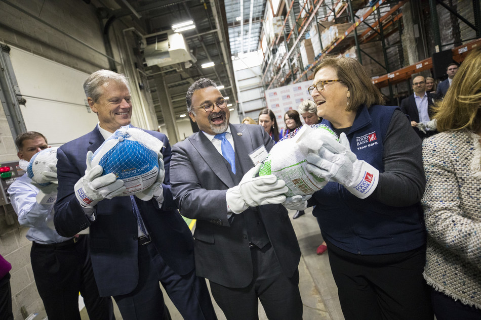 Massachusetts Government Charlie Baker, Ocean Spray CEO and President Bobby Chacko and The Greater Boston Food Bank President and CEO Catherine D'Amato at The Greater Boston Food Bank's 14th annual Chain of Giving event in Boston.