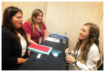 Participants of the College Women on the Rise program practice their job interviewing and pitching techniques with each other during a breakout activity at job readiness workshops hosted by UMA.
