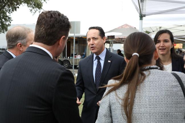 Texas Senator José Menéndez speaks with Endeavors leadership at the groundbreaking event.