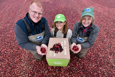 Ocean Spray Vice President of Marketing Chris O'Connor, left, and Farmer-Owner Sue Gilmore, welcome HelloFresh Head Chef and Head of Recipe Development Claudia Sidoti, center, to their family farm to announce the Farmer-Owned Cooperative Ocean Spray as the exclusive cranberry provider for the home meal preparation company in Carver, Mass. (Josh Reynolds/AP Images for Ocean Spray)