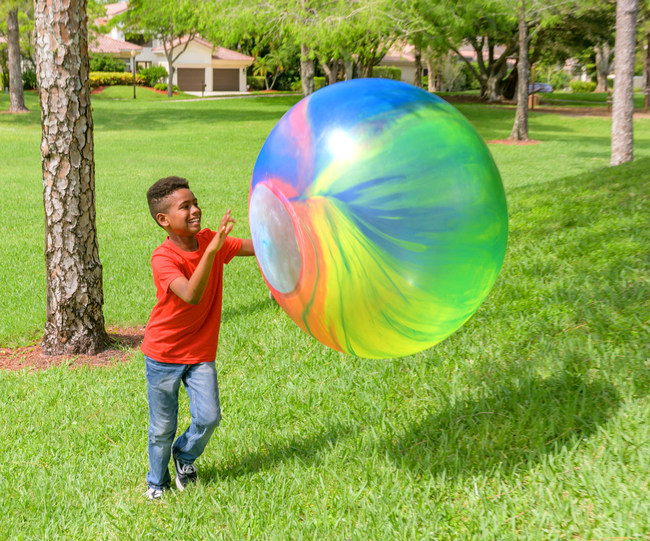 Introducing Groovy Wubble - the Super Wubble bubble ball with a multi-colored tie-dye design. No two balls are alike!