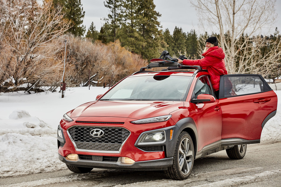 WSL professional surfer Sage Erikson loads her snowboard on top of a 2020 Hyundai Kona with a Thule rack