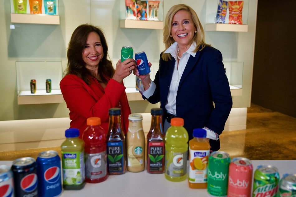 President of Carnival Cruise Line Christine Duffy (L) and president of PepsiCo Global Foodservice Anne Fink (R) toast to their new partnership that will bring PepsiCo's broad portfolio of beverage brands on board the cruise line's North American fleet in 2020.