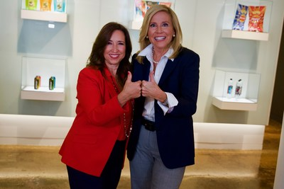 Christine Duffy (L), president of Carnival Cruise Line, and Anne Fink (R), president of PepsiCo Global Foodservice, create the Carnival funnel symbol to celebrate the coming together of two fun-filled U.S. companies.