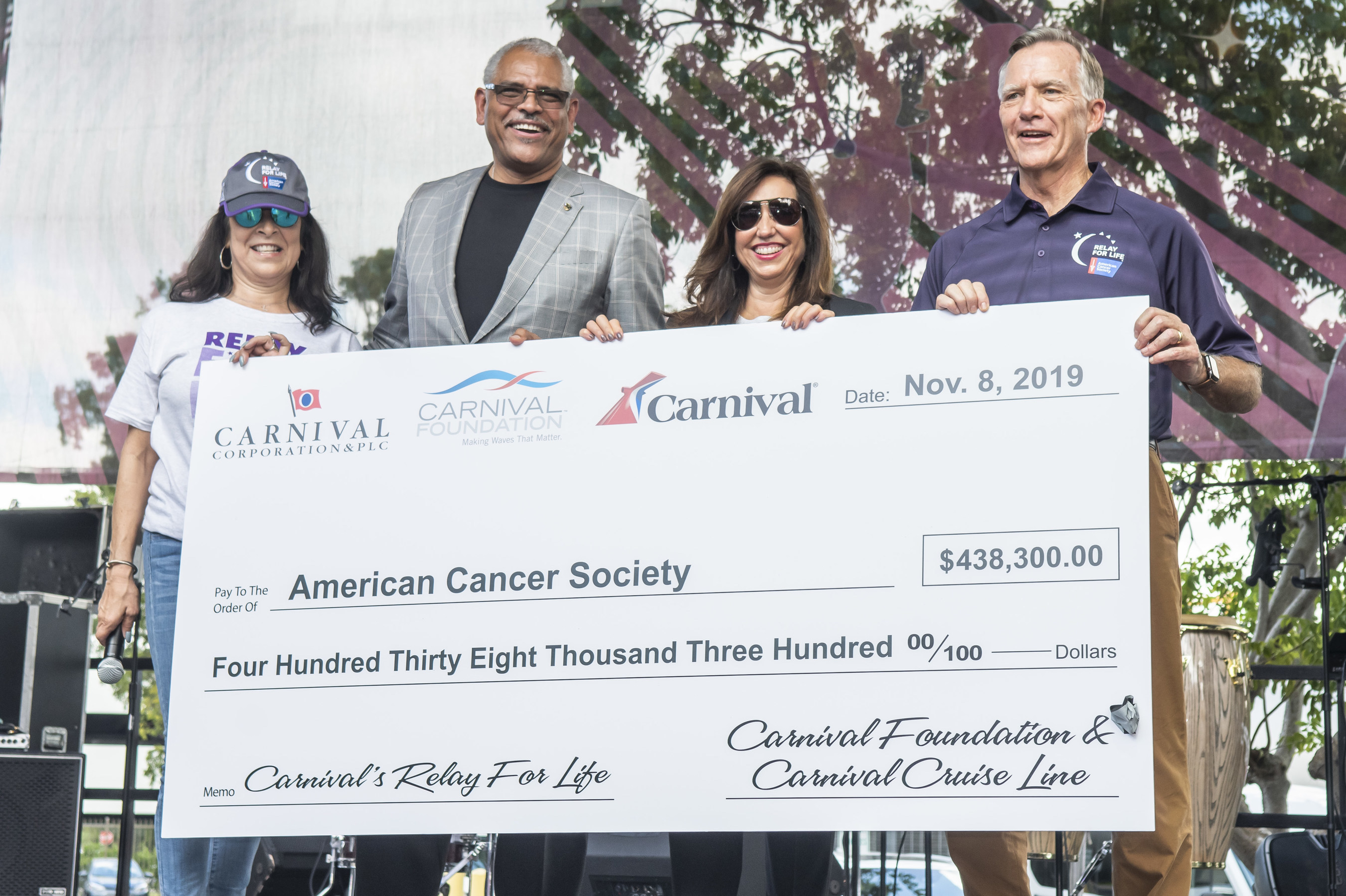 Linda Coll (left), executive director of Carnival Foundation; Arnold Donald, president and CEO of Carnival Corp.; and Christine Duffy, president of Carnival Cruise Line; presented a check for $438,300 raised to date to Gary Reedy (right), CEO of American Cancer Society (CREDIT: Carnival Foundation)