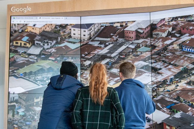 Students view the impact of urban sprawl through the dynamic artwork of Edward Burtynsky. Photo: Tanya Kirnishni/ Canadian Geographic (CNW Group/Royal Canadian Geographical Society)