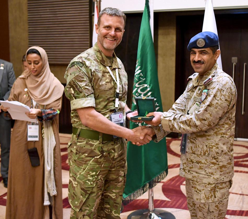 A participant in the 1st KSA-UK Workshop on Stabilisation with Saudi Royal Air Force Gen. Abdullah Alhababi (right) in Riyadh, Saudi Arabia (14 Nov 2019)