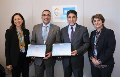 "Dr. Hani Jokhdar, Deputy Minister for Public Health, receiving the ""Healthy City"" Certificates for Unayzah & Riyadh Al Khabra from Dr. Ahmed Al-Mandhari, WHO Regional Director for the Eastern Mediterranean."