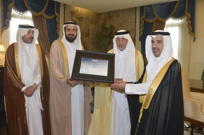"Makkah governor Prince Khaled Al-Faisal receiving the World Health Organization's certificate declaring Makkah's Al-Jumum city the ""First Healthy City"" in the region and ""The Third"" in the Kingdom from Health Minister Dr. Tawfig AlRabiah."