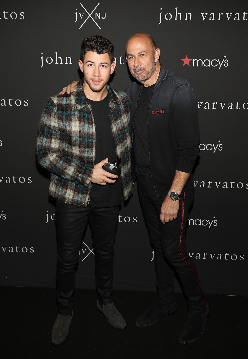 International Menswear Designer John Varvatos And Musician And Actor Nick Jonas Celebrate The Launch Of Their New Fragrance, JVxNJ Silver Edition. (Alex Tamargo/Getty Images)