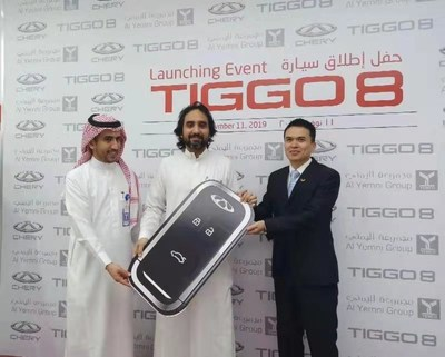 Yuan Ming (R), Vice-General Manager of Chery International Middle East, delivers the car keys to the first batch of pre-sold Tiggo8 owners in the Tiggo8 new product launch event in Saudi Arabia on, November 11, 2019