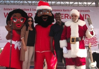(L to R) Mrs. C., Rachel Freeman (Capri Retail Services), Black Santa, Los Angeles City Councilmember Marqueece Harris-Dawson (District 8) and Santa Claus. Photo Credit: Ricky Richardson